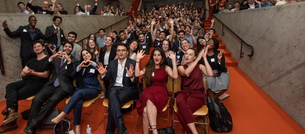 Students cheer during demo day.