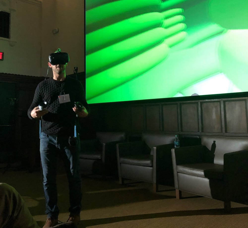 Wainstein demos virtual reality at Yale's Day of Data event.