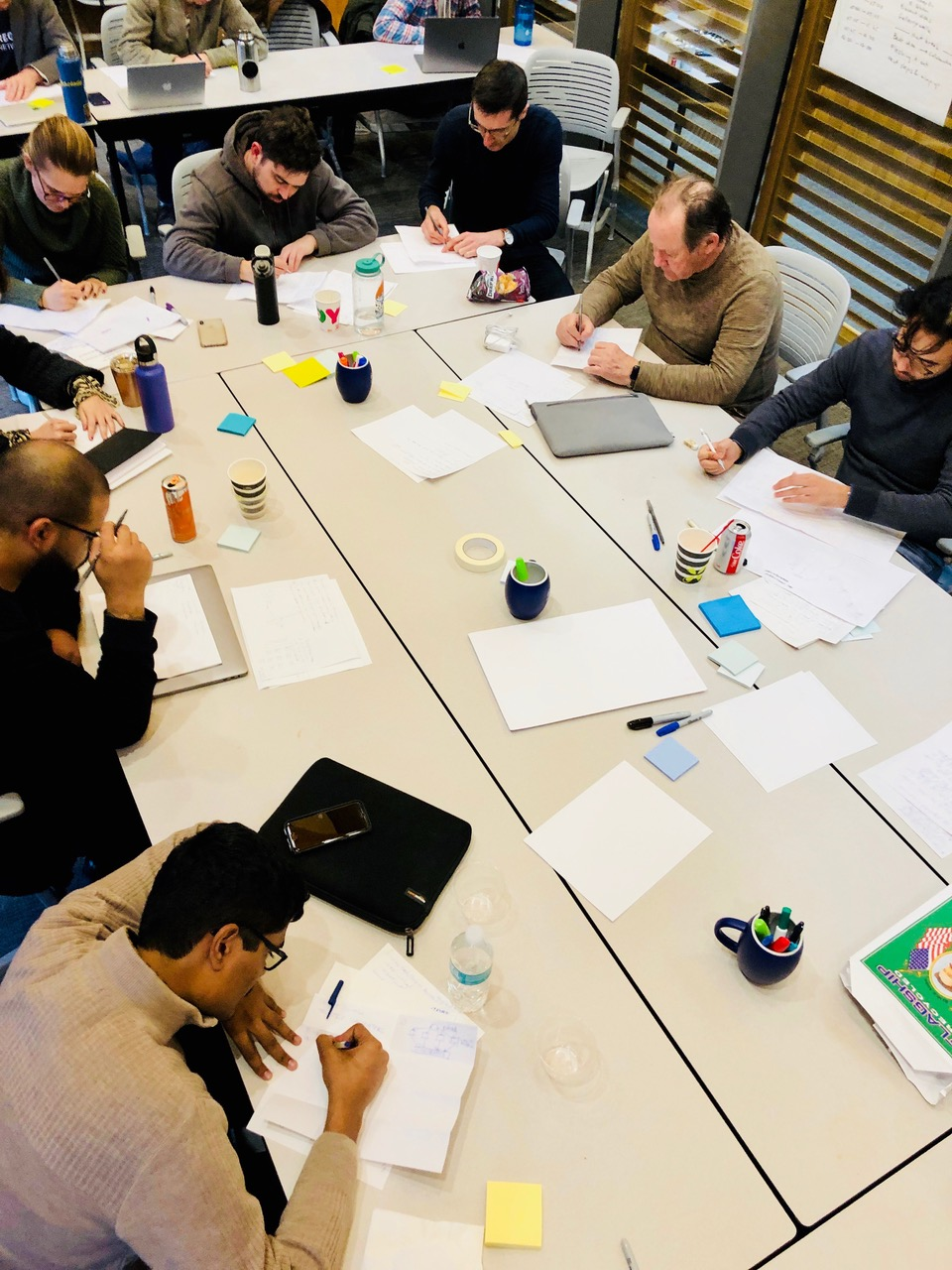 Ideation and brainstorming - Participants spent time individually brainstorming potential approaches and practices for securely connecting sensor data and blockchain-based carbon accounting, using basic materials like paper, pens, and post-its to give form to their ideas.