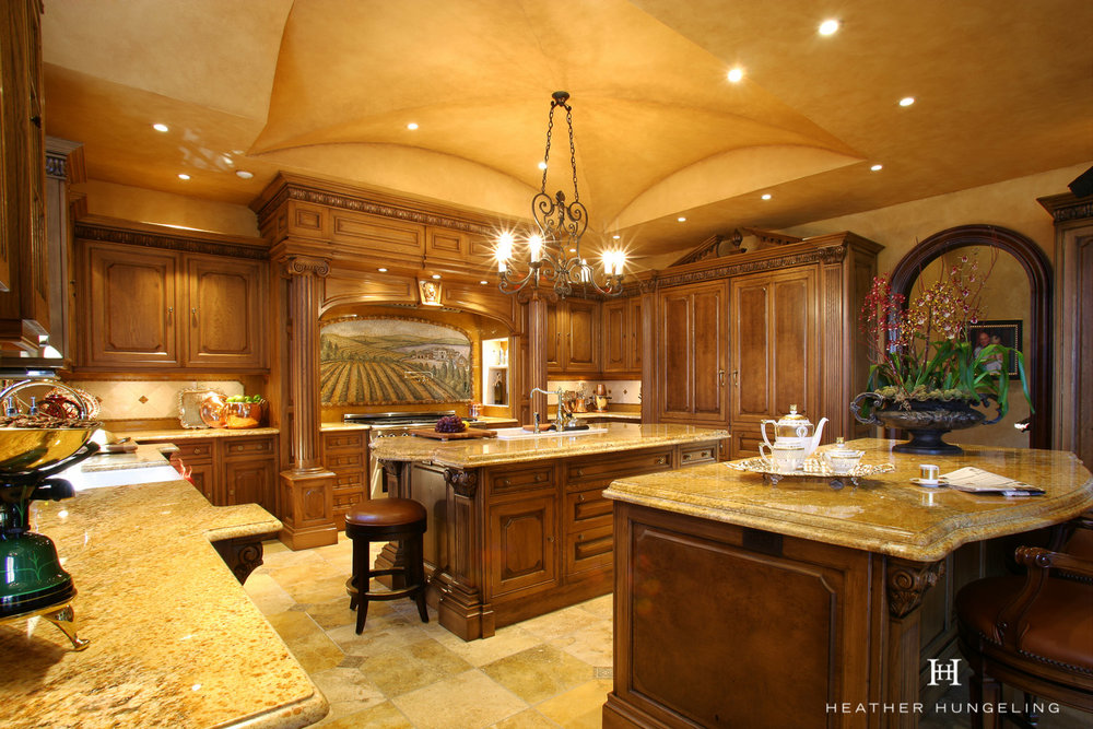Two islands divide task areas in this large Tuscan kitchen, featuring Clive Christian cabinetry.