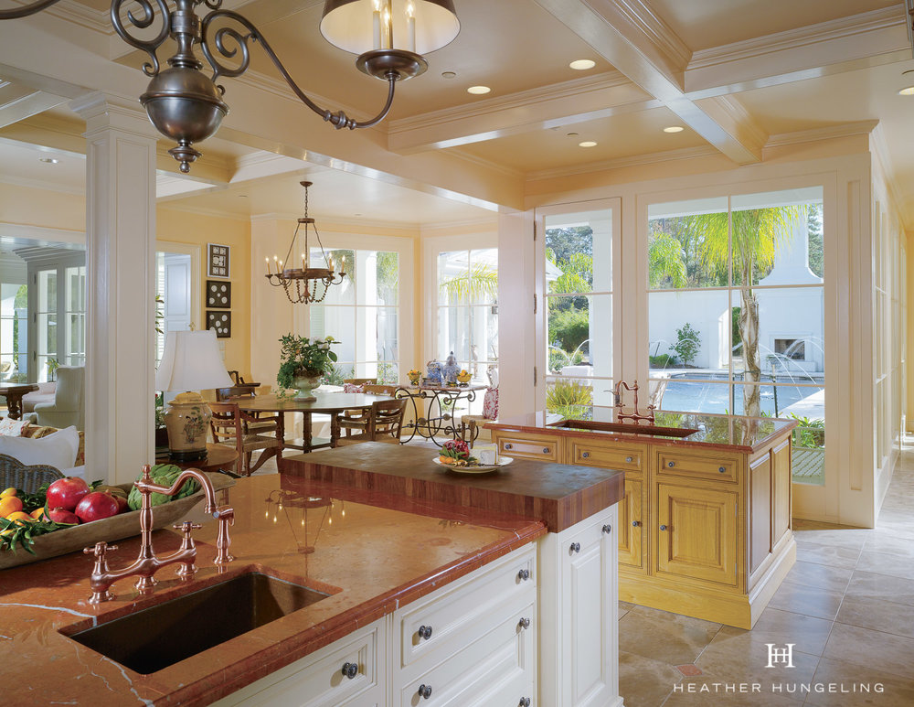 A second island is oriented the other direction and serves an entirely different purpose than the main island. It fills the length of the room without becoming an impediment to the flow of the kitchen.