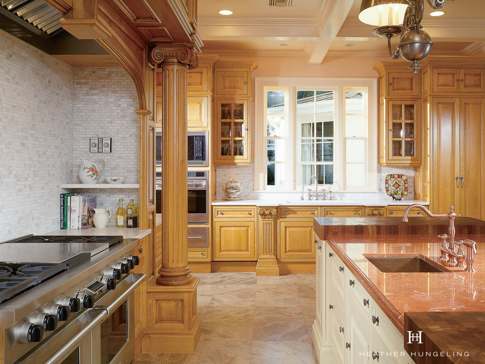 Tall elements flank the window and balance the heaviness of the hood surround.