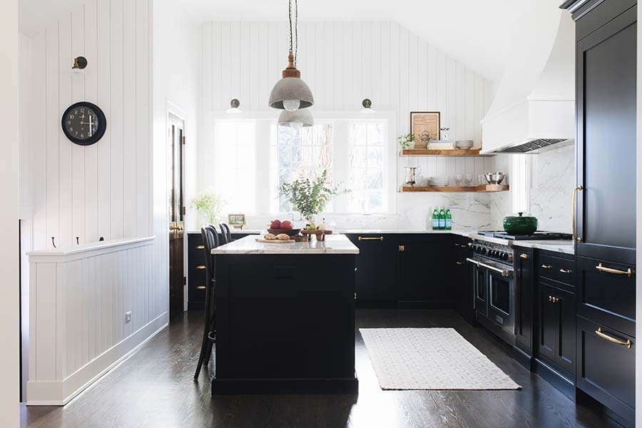 Source:  reDesign Home LLC . A lovely example of the black and white kitchen trend. Crisp white shiplap walls, black cabinetry, white marble and distressed wood as accents.