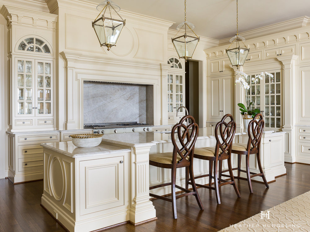 Tailored wood mantle range hoods have an important role to play in traditional design, especially when working with historic homes.  Source:  Heather Hungeling Design (Wentworth Place)