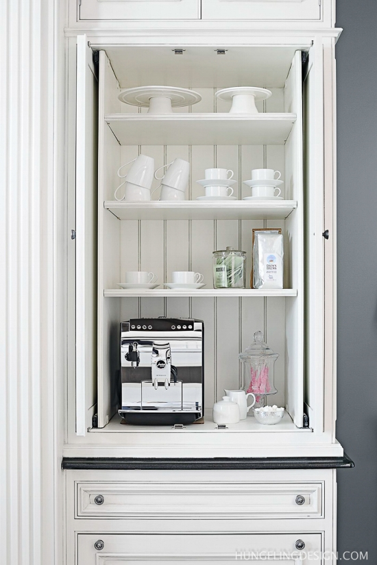 When creating a coffee bar inside of a cabinet, be sure to allow room for pocket doors that will open and tuck back out of the way while in use. Pretty bead board accents the back of this cabinet so it looks good even when it's left open.  Source:  Heather Hungeling Design