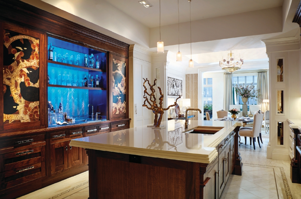 Clive Christian kitchen for Kips Bay 2016 Showcase House. Shown in Warm Walnut with Custom Marquetry Inlay on sliding doors.