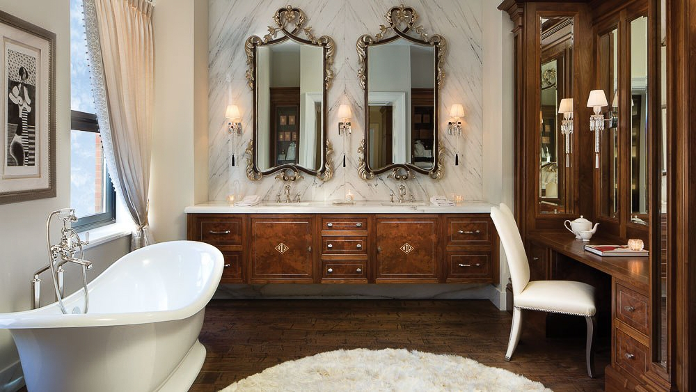 Clive Christian luxury walnut bathroom with floating vanities and dedicated make-up area. Image courtesy of Clive Christian Chicago Lifestyle Apartment.