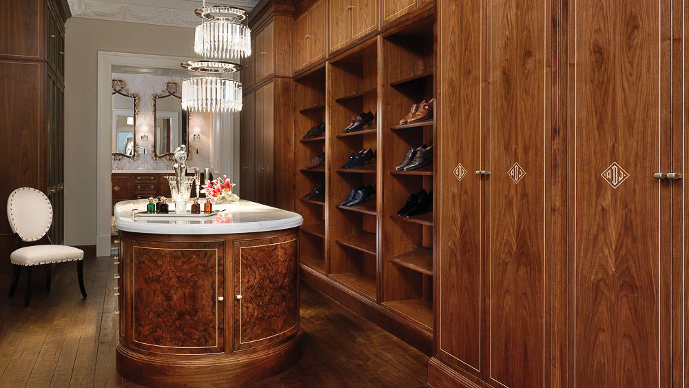 Clive Christian luxury dressing room in walnut with custom marquetry. Image courtesy of Clive Christian Chicago Lifestyle Apartment.