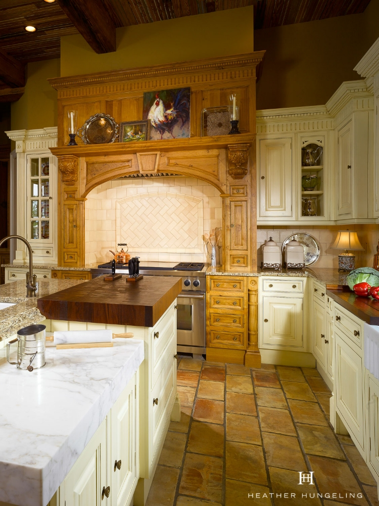 This is a great example of how to use marble in a kitchen if your concerned about its durability. Here, White Calacatta Gold marble is used on this island as a designated baking area, while the remainder of the kitchen countertops are either wood or granite.