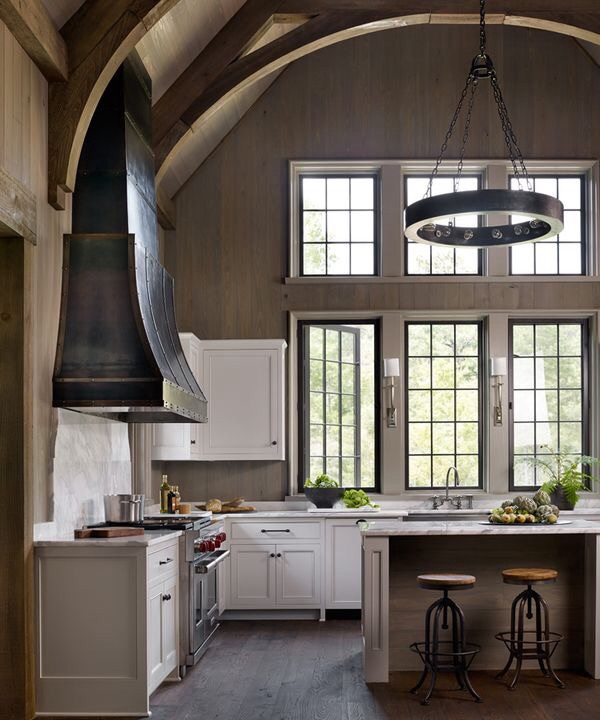 A large kitchen window design idea with a vaulted ceiling and planked walls.  Source: Jeffrey Dungan Architects