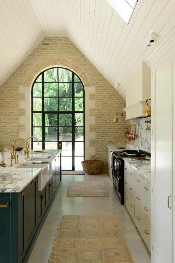 Looking for a large kitchen window design idea? How about a door instead? This kind of kitchen layout can feel less contrived-even if it's implemented in new construction. Source: DeVol Kitchens