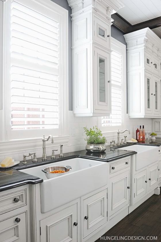 Instead of one large kitchen window design idea, how about using two symmetrical windows? This takes advanced planning to correctly space the windows to suit your sink sizes and the dishwashers.