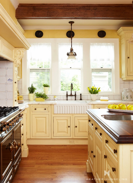 This charming Clive Christian kitchen shows that authenticity is the best large kitchen window design idea here.