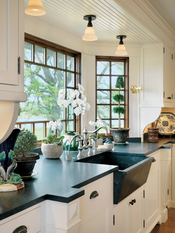 Bay windows are not incorporated into new construction homes very often these days, but they make a high impact large kitchen window design idea, as they elongate the view of your room.  Source: Anthony Catalfano Interiors