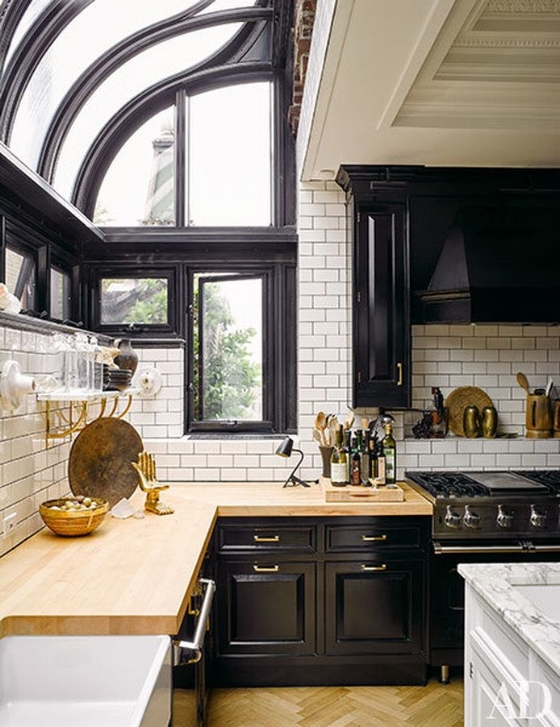 Conservatory style windows are popping up all over and can make a stylish large kitchen window design idea if your room can handle that high amount of sunlight.  Source: Nate Berkus via Architectural Digest