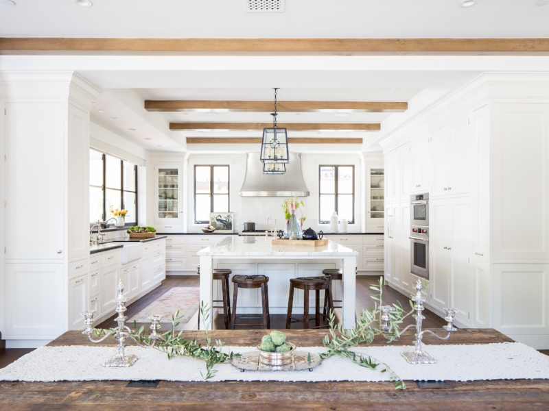 These homeowners scored a kitchen that will never go out of style.  With clean, white, shaker-style cabinetry, this dream kitchen proves that timeless is the way to go.  Source:  Cooper Pacific