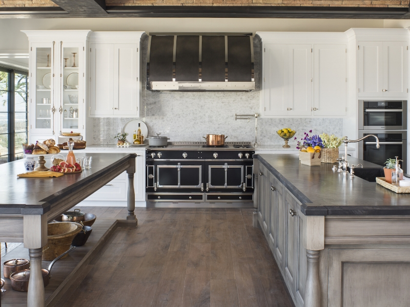 This interesting dream kitchen by Cooper Pacific Kitchens, is loaded with character.  The La Cornue gives it an instant dose of history and charm, while the rustic beams & brick ceiling provide texture.
