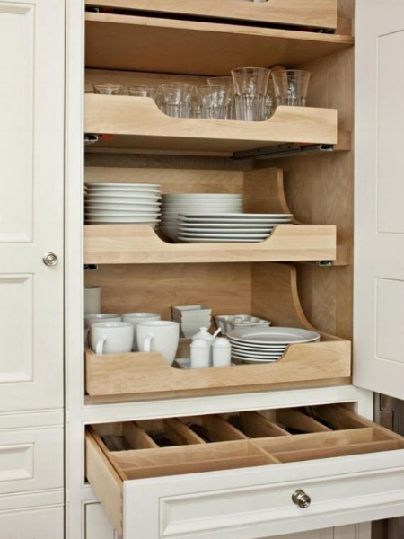 Roll-out shelves work great in tall, deep cabinets, but make sure that you don't place them too high above shoulder level.