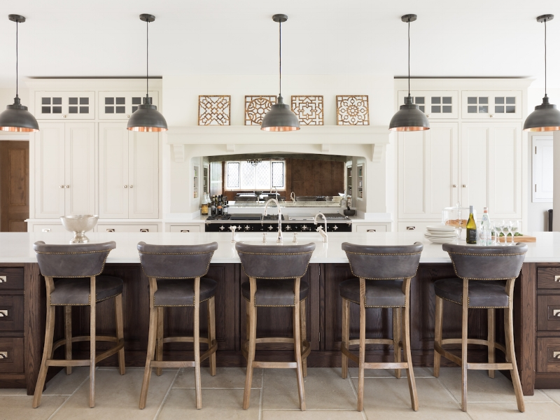 In this beautiful dream kitchen, by Humphrey Munson, a very long island works well because it provides the cook with an uninterrupted work zone on one side and a place for family and guests on the other.