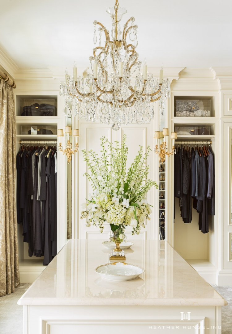 Find the perfect light fixture or vintage chandelier to complete your luxury closet. My client re-used an antique fixture from her childhood home that had special sentimental value. Get more of  My Top 10 Tips to Create the Perfect Luxury Closet . Source: Hungeling Design