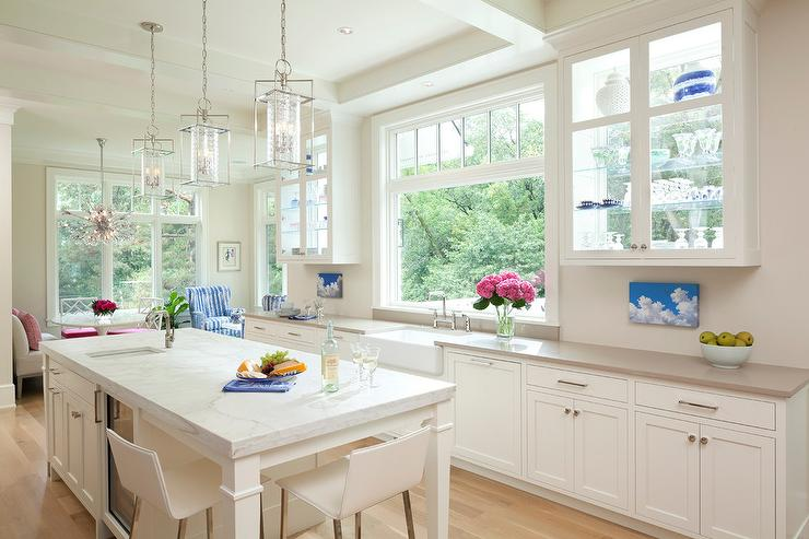 How to Make Your Kitchen Beautiful with Pretty Cabinet Details, Part 1 (Cabinet Interiors)  Glass cabinets positioned in front of customized windows have an obvious advantage…they provide tons of light without sacrificing cabinet space. #kitchencabinetdetails.