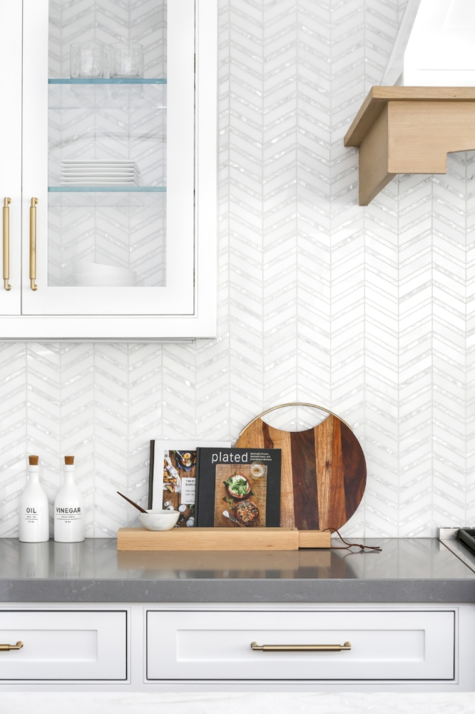 How to Make Your Kitchen Beautiful with Pretty Cabinet Details, Part 1 (Cabinet Interiors).  A white and Mother of Pearl backsplash deliver extra sparkle when combined with backless glass cabinets. #kitchencabinetdetails.