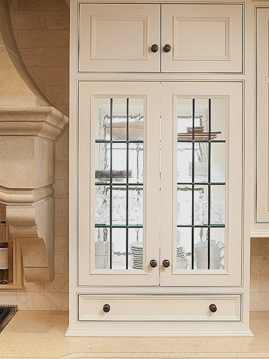 Glass Cabinet Positioned In Front of Window