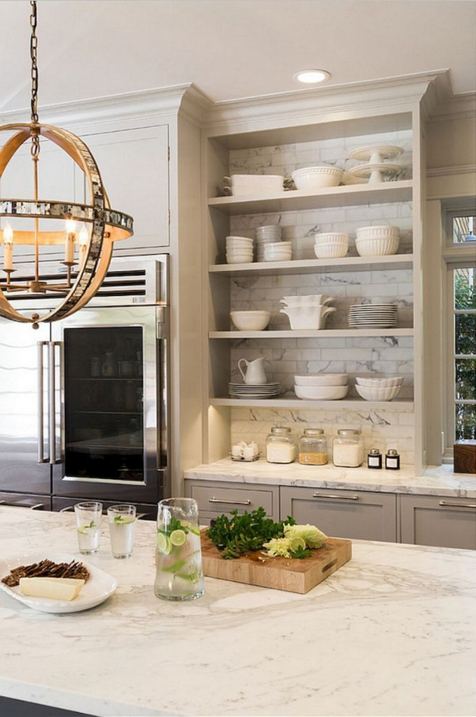 How to Make Your Kitchen Beautiful with Pretty Cabinet Details, Part 1 (Cabinet Interiors).  Introducing some open, backless cabinetry into a kitchen breaks up the monotony of cabinet boxes hanging on the wall and allows you to introduce more visual continuity with your backsplash tile. #kitchencabinetdetails