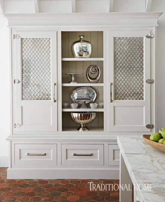 Cabinet door details, such as these mesh panel inserts, create lots of interest in a kitchen. Use them on a few key cabinets as a dramatic accent, which will take your kitchen from ho-hum to amazing. Discover other interesting cabinet door styles that you can use to infuse needed character into your kitchen.