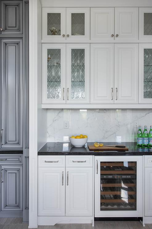 Leaded glass cabinet doors may not be common place right now, but they are still a timeless alternative to cabinetry muntins for creating interest in your kitchen.