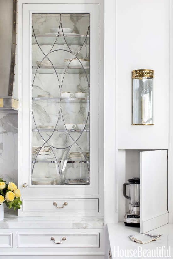 These have to be the prettiest leaded glass cabinet doors I've ever seen. Notice how the cabinet was made backless so that you can see the movement of the marble through the glass?
