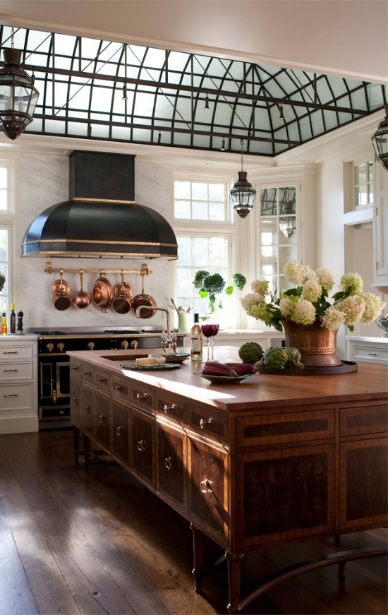 A furniture-style island with walnut veneers shows that it pays off big to focus on pretty cabinet door styles. Kitchen designed by Austin Patterson Disston Architects.
