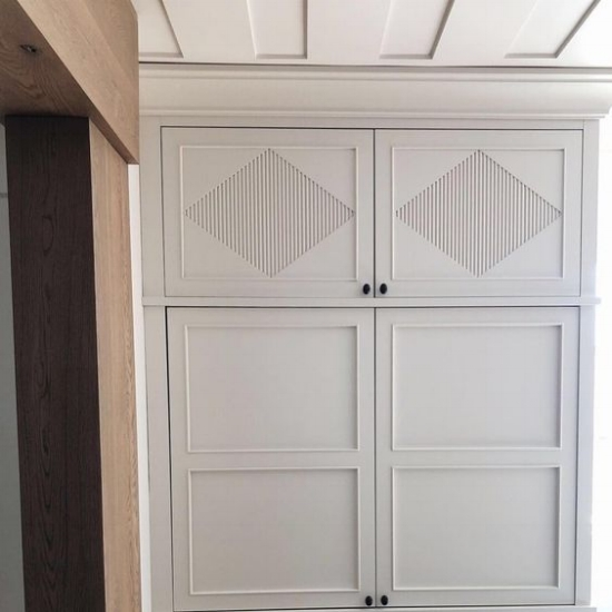 A work in progress shot by Alice Lane Interiors. Cool cabinet door styles like this one can transform a kitchen from basic to stunning.