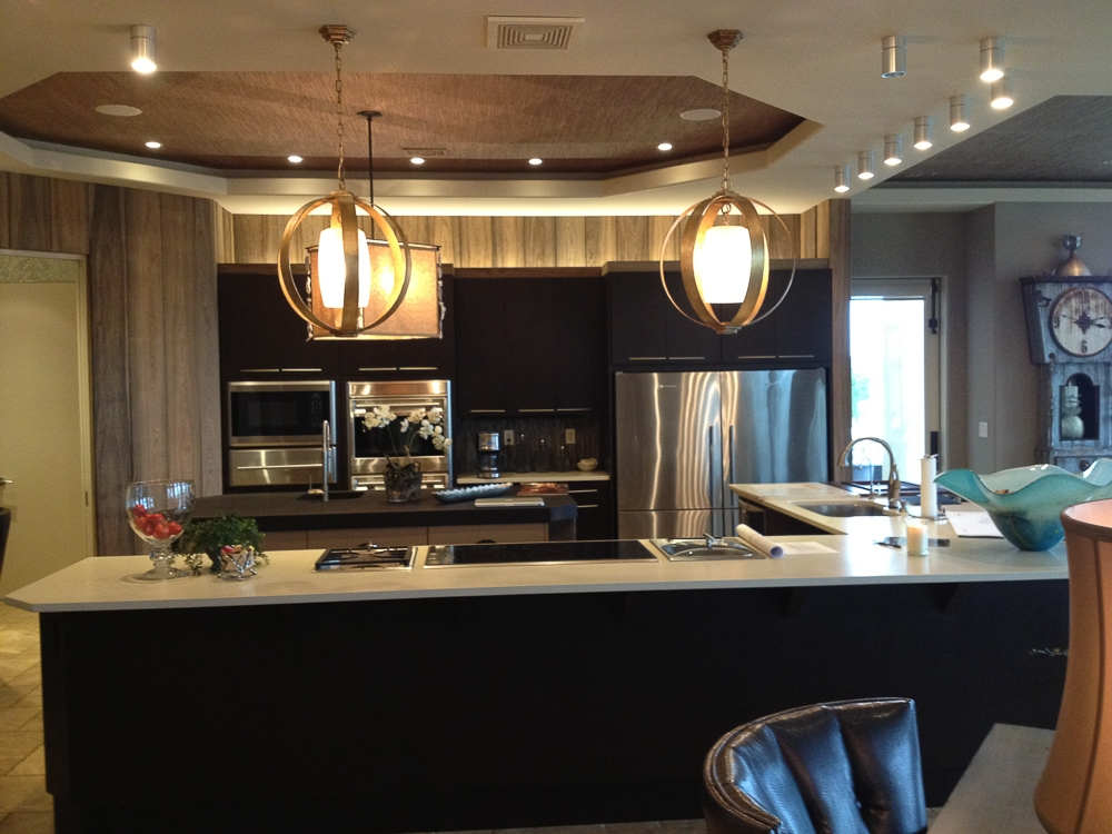 """Willow Lane Project """"Before"""" Image. Discover how a double island kitchen design transformed this windowless kitchen into a bright and open space."""