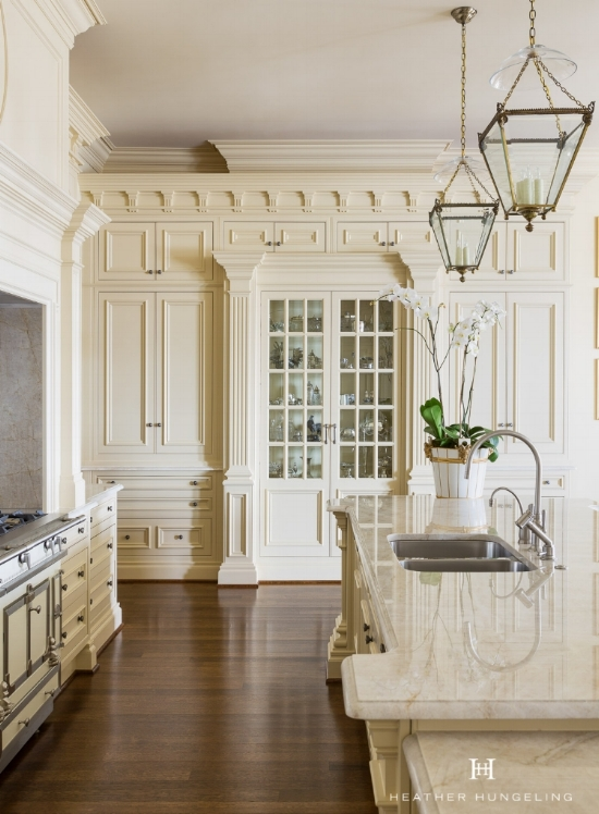 Cream kitchen cabinets have been a mainstay with the luxury market. This kitchen features cabinetry painted in Sherwin Williams Believable Buff.