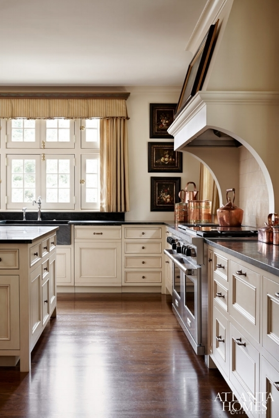 Cream kitchen cabinets look fresh when the same cream color is applied to the walls and trim.