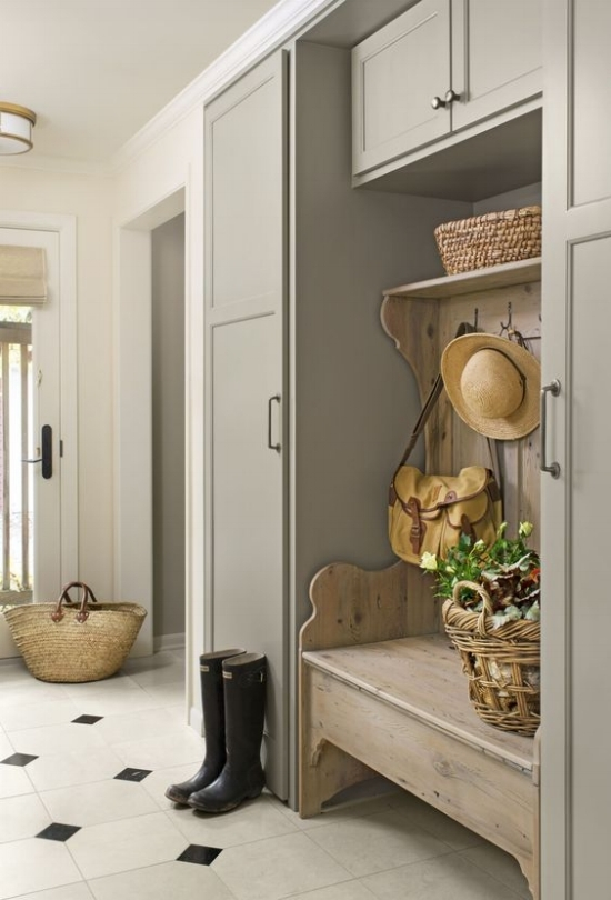 The mushroom color in this laundry room is a harbinger of the return in popularity of cream kitchen cabinets.