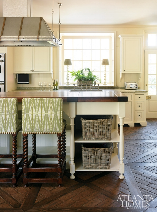 When I think of cream kitchen cabinets, I envision a kitchen just like this. Warm, inviting, and filled with lots of texture. To keep the look as fresh as possible, consider painting your walls and trim all in the same color as the cabinetry.