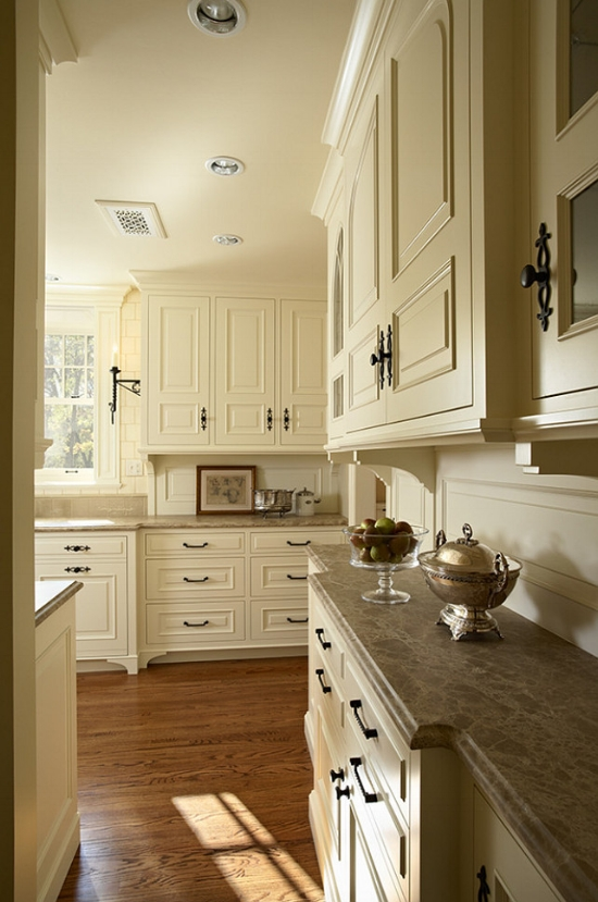 Rich, cream kitchen cabinets can work for an older home where maintaining an authentic environment is desirable.