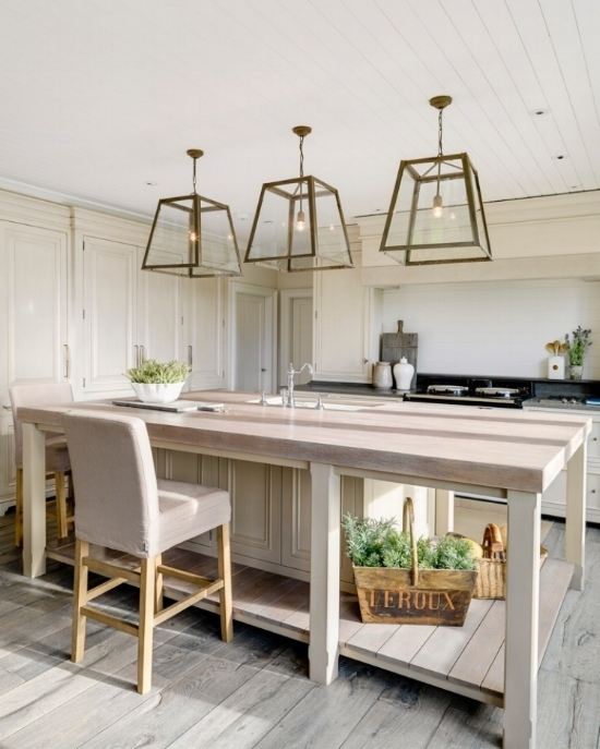 Cream kitchen cabinets work nicely with the aesthetic of this kitchen and pair well with the bleached oak island countertop. Designed by Andrew Ryan Design.