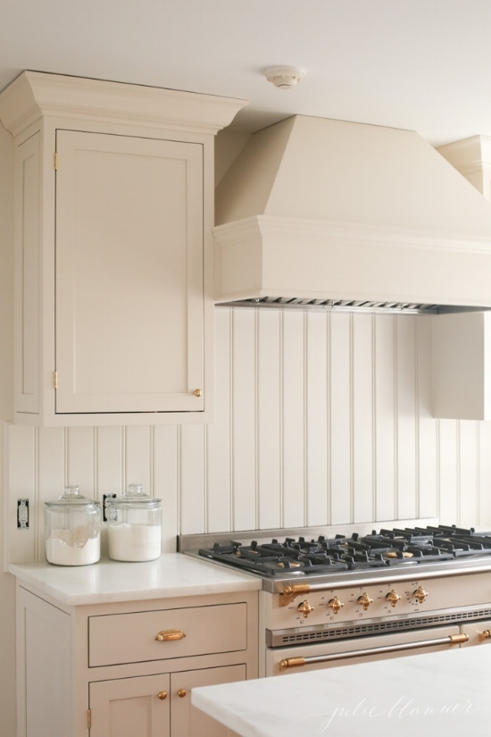 Blogger, Julie Blanner, wrestled with the exact color she wanted to use for her cream kitchen cabinets. After trying many samples, she finally color-matched the cabinetry to her Lacanche range.