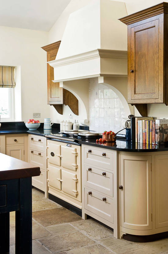 A more traditional cream-colored AGA suits the lighter color scheme of this English kitchen.