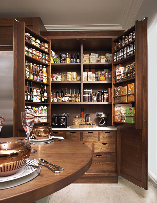 A well-stocked larder for an English kitchen. This feature can be incorporated into kitchen designs here in the U.S. as well, as they offer additional food organization and storage for coffee makers and small kitchen appliances. By cabinet maker, Tom Howley.
