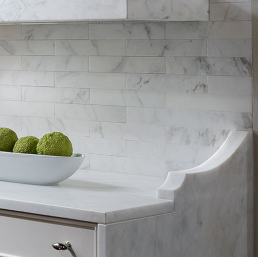 Marble brackets have been combined with the effect of a waterfall countertop in this kitchen. See the rest of my  9 Kitchen Marble Ideas  for using more of the marble that you love.