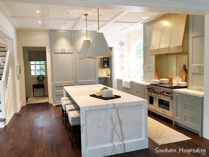 A marble waterfall island top gets a special paneled detail that visually softens it just a bit for this traditional kitchen. See more of my  9 Kitchen Marble Ideas…for When You Really Love Marble.