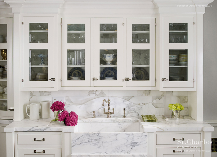 This marble sink is further accentuated with a scalloped marble backsplash detail. Kitchen Marble Ideas.