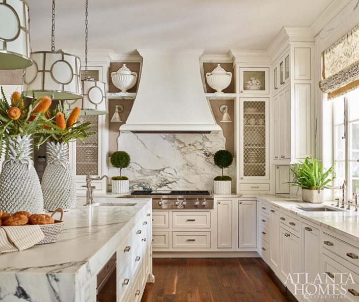 A marble slab is crafted into a decorative backsplash and makes a strong feature above the range in this kitchen. Kitchen Marble Ideas.