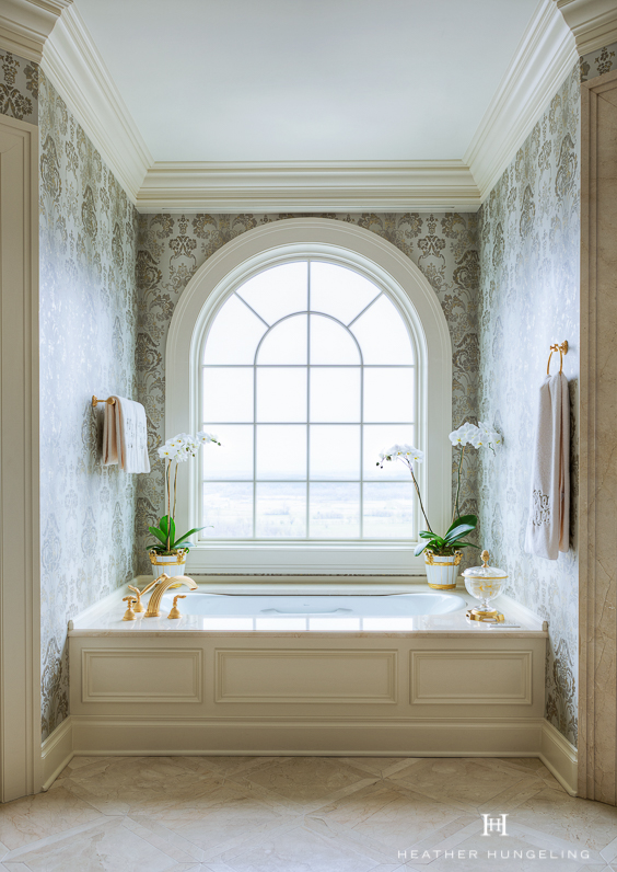 If an elegant master bathroom is on your wish-list, then take a look at this exquisite Georgian-style home. A beautiful view from the window is just the cherry on top when you've got a setting like this. See more Master Bathtub Ideas. #luxurybathrooms, #traditionalbathroom, #whitebathrooms, #clivechristian
