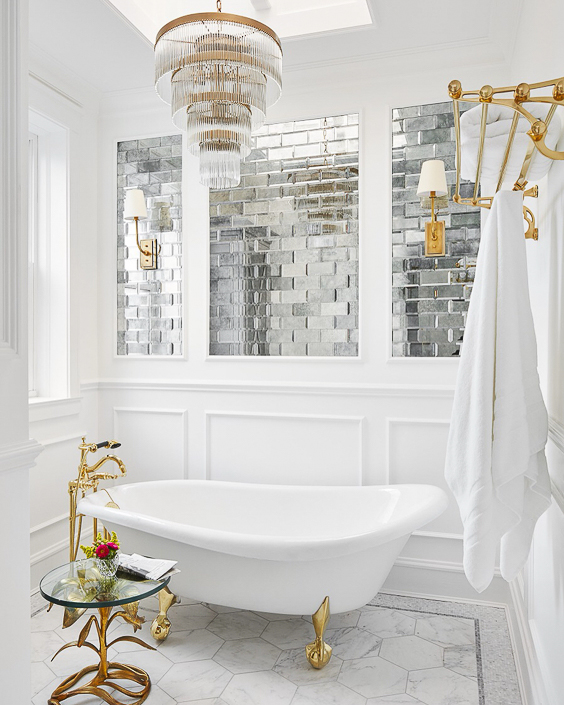 I love how the designer integrated the crisp, white paneling with the mercury glass tile work above the freestanding tub. See more Master Bathtub Ideas. #luxurybathrooms, #traditionalbathroom, #whitebathrooms  Designer: SuzAnn Kletzien Design