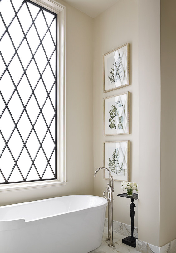 If you don't have the advantage of a private view from your master bathroom, consider using a leaded glass window. Architect Jeffrey Dungan brings his signature look to this bathroom by combining it with an almost modern freestanding bathtub. See other Master Bathtub Ideas. #luxurybathrooms, #traditionalbathroom